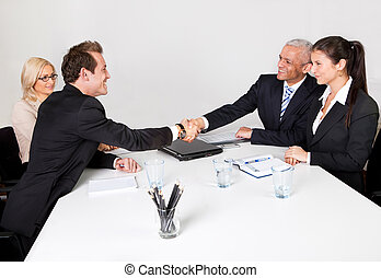 Team of business people closing the deal