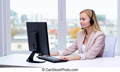 businesswoman with computer and headset talking