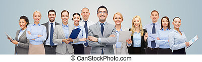 group of happy businesspeople over blue background