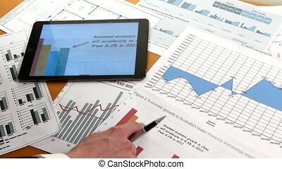 Business people developing a business project and analyzing market data information