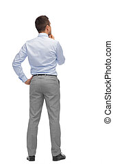 businessman thinking from back