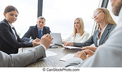 Business people discussing a finance