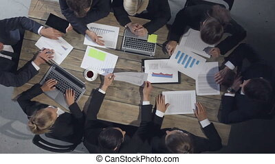 Business people discussing charts and graphs