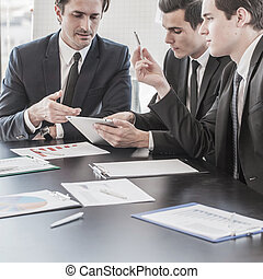 Business people discussing charts