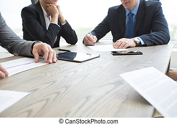 Business people discussing contract