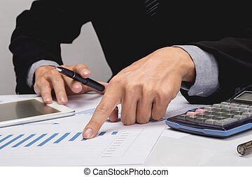 Business people discussing financial charts - closeup shot of hands over table