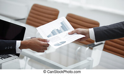 Business people discussing financial graphs