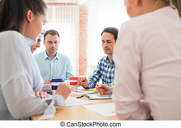 Business people discussing financial matter