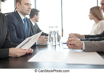 Business people discussing reports