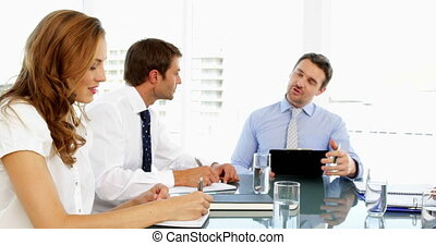 Business people discussing together during meeting in the...