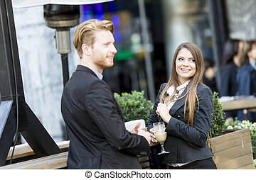 Business people drinking coffee