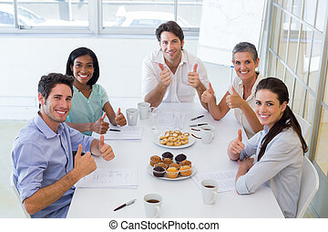 Business people eating muffins give