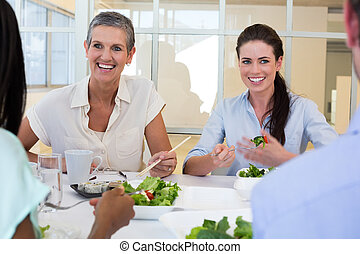 Business people enjoy healthy lunch