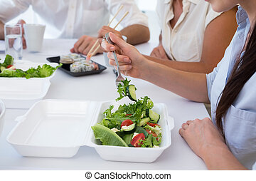 Business people enjoying salad and