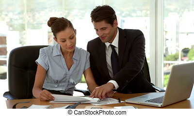 Business people examining a document in the office with a...