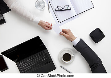 Business People Exchanging Visiting Card At Office Desk -...