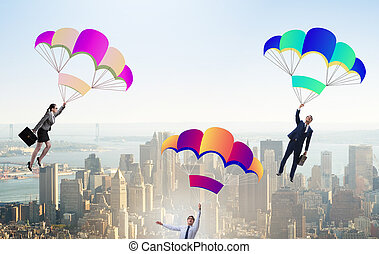 Business people falling down on parachutes
