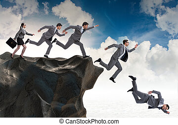 Business people falling off the cliff