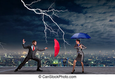 Business people fighting with umbrellas in a thunderstorm