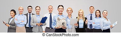 group of happy businesspeople with money bags