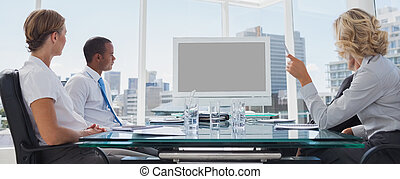Business people gathered during a video conference in the ...