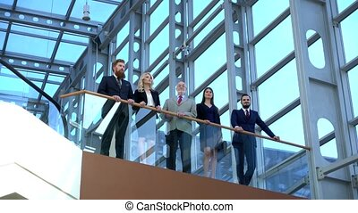 Business people giving thumbs up - Successful positive group...