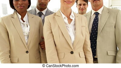 Business people giving thumbs up to camera