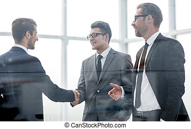 business people greeting each other with a handshake