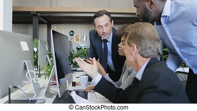 Business People Group Discussing Data On Computer Monitor, Buinessmen Help Buisnesswoman With Work, Successful Team In Modern Office