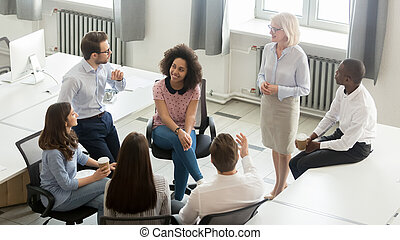 Business people group discussing work plan with coach at meeting