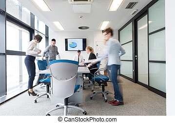 business people group entering meeting room, motion blur -...