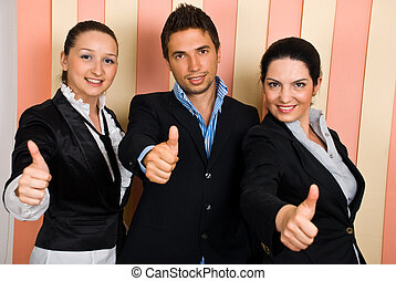 Business people group give thumbs up