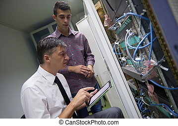 network engineers in server room