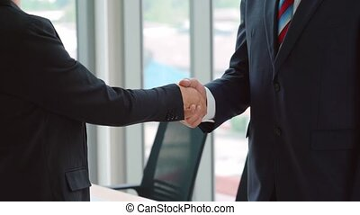 Business people handshake with friend at office showing trust , friendship and success celebration .