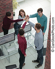 Business people happy showing team work and giving five in offic