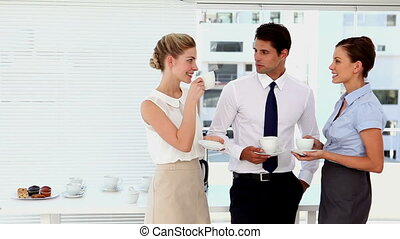 Business people having a coffee at break time and chatting...