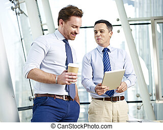 business people having a discussion - two caucasian...