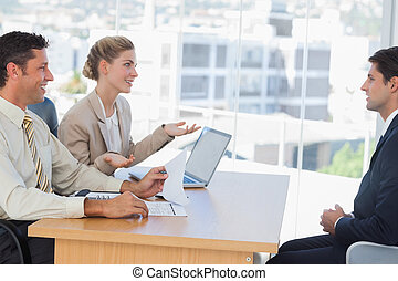 Business people having an interview in their office