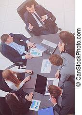 Business People Having Board Meeting In Modern Office.