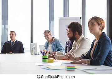 Business people having meeting in modern office.