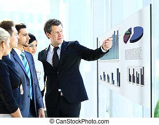 Business people having on presentation at office. Businessman presenting on glassboard.