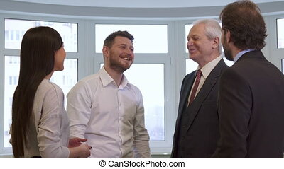 Business people hihg-fiving at the office