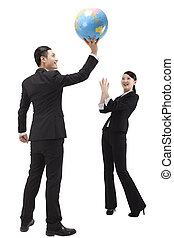 Business people holding a globe