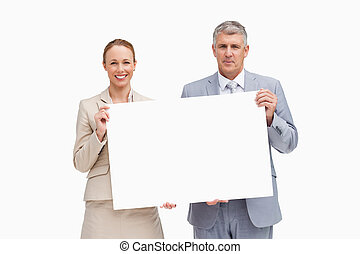 Business people holding a poster