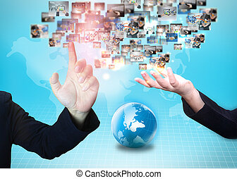 Business people holding business world