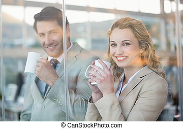 Business people holding cup