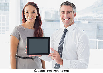 Business people holding up tablet