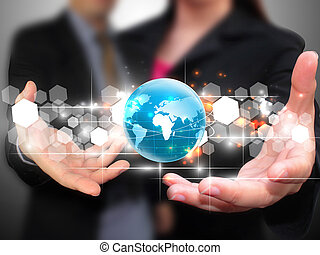 Business people holding world