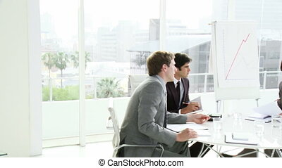 Business people in a meeting in an - Multi ethnic business...