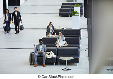 Business people in airport lounge